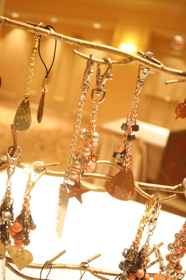 A selection of Elegant Insights jewellery hanging from a stand