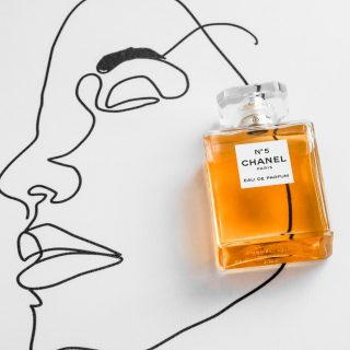 \chanel perfume bottle on illustrated face