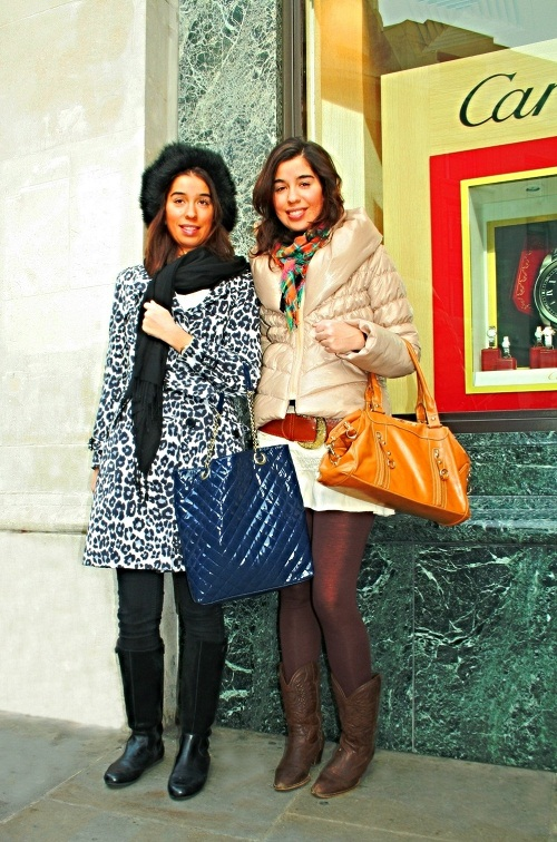 Image of twin sisters standing outside Cartier in Central London