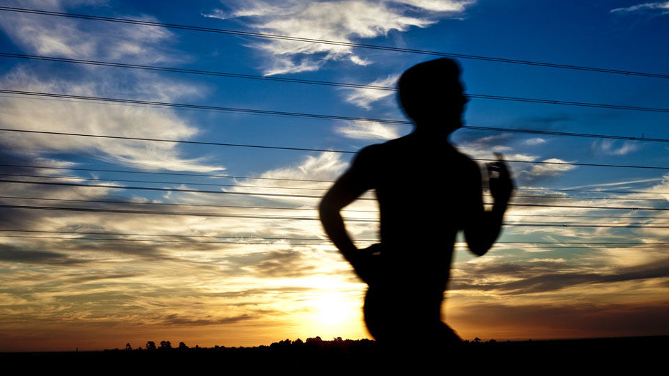 Image of man running in the sunset