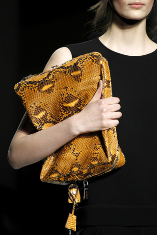 Snakeskin bag held close to the body in mustard...simply delicious!