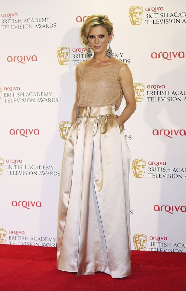 Emilia Fox in gold floor length gown