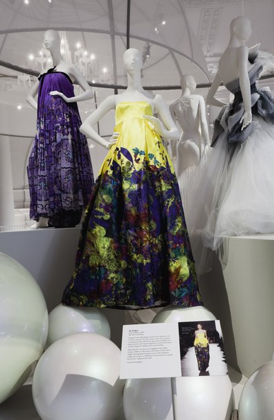 Floral ballgowns on dummys, displayed at the V&A