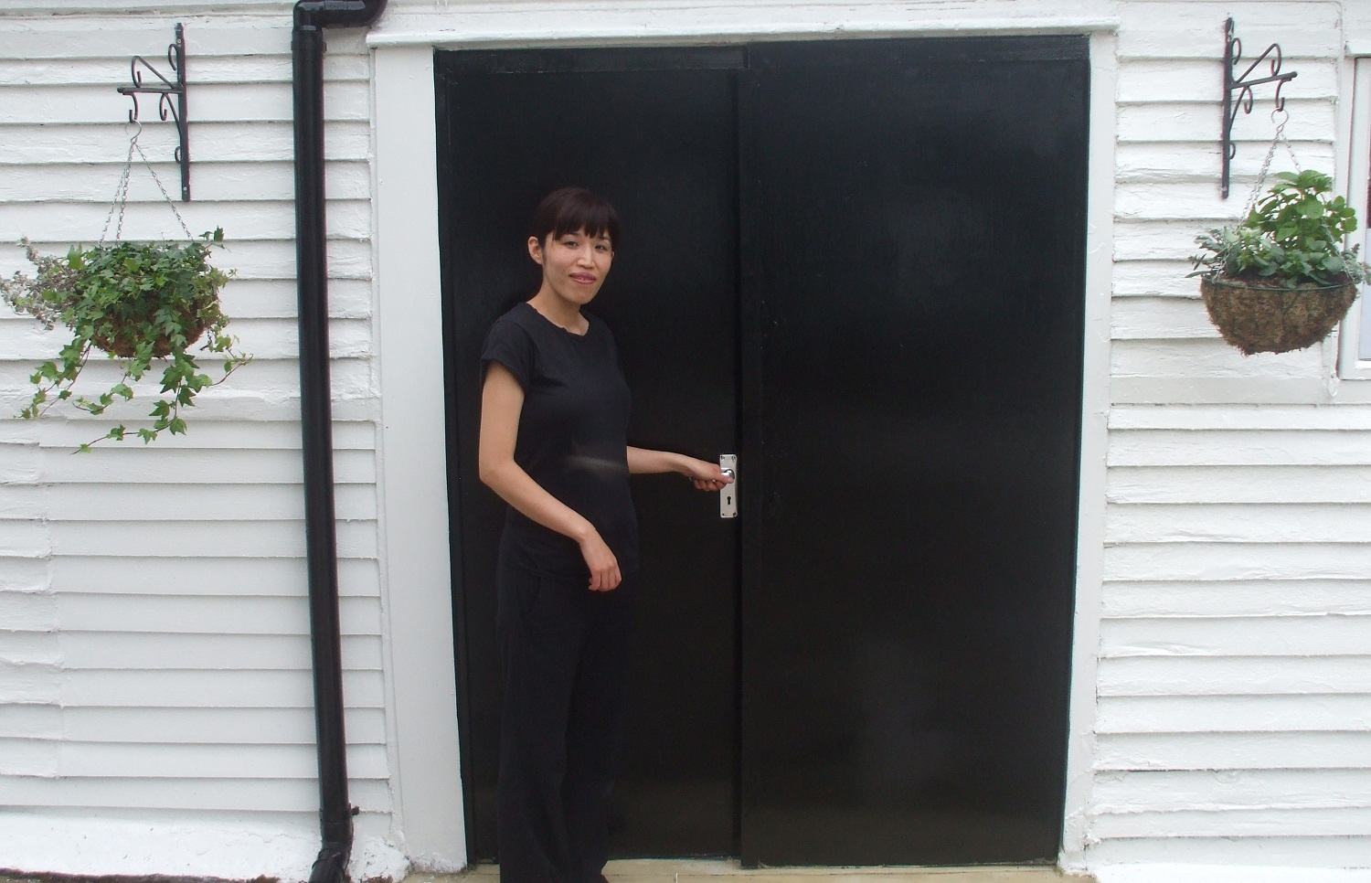 Emi Hojo outside of her salon