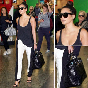 Kim Kardashian in two tone monochrome trousers and black vest