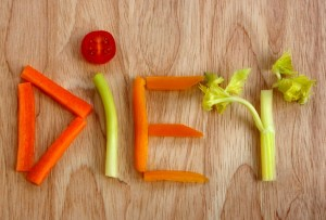 Diet spelled out with vegetables on chopping board