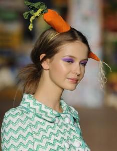 Model in carrot hat