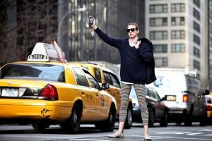 Man in leggings flagging a cab