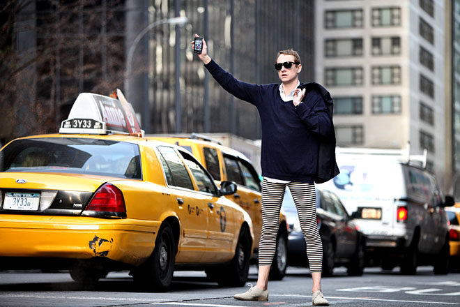 Man in leggings flagging a cab
