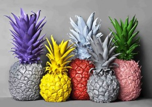 No artificial colours- pineapples in a row with brightly coloured paint. Some are grey (void of colour)