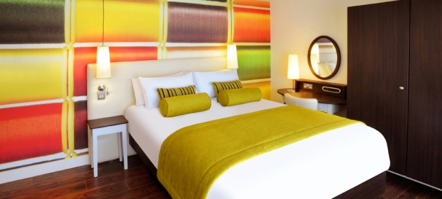 Brightly coloured bedroom at Hotel Indigo