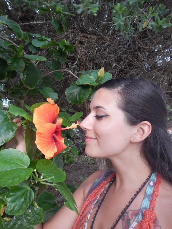 Lauren Metzler sniffs an exotic flower