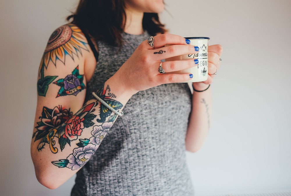 Tattood woman with tea cup