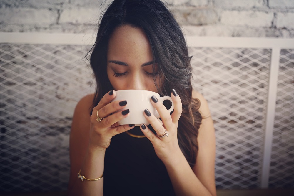 woman-drinking-a-hot-drink
