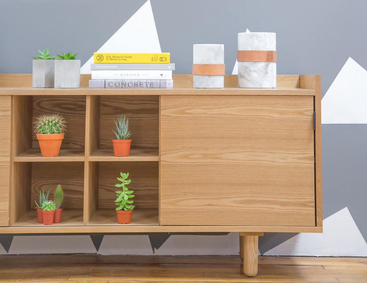 Cupboard with potted plants in sections