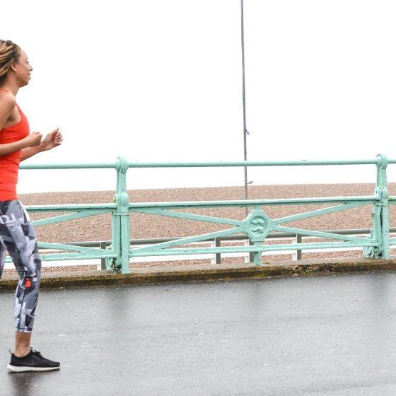 Eshe running on Brighton pier