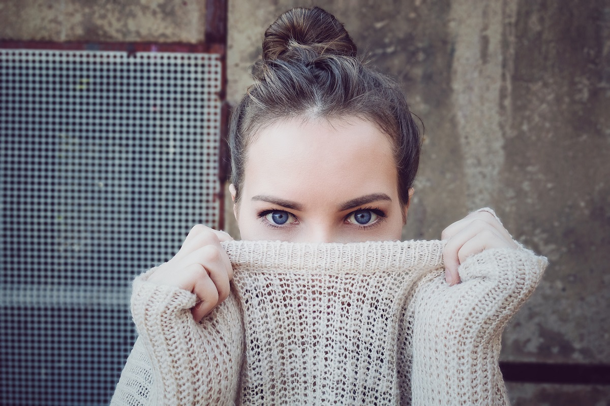 Woman with jumper just showing eyes