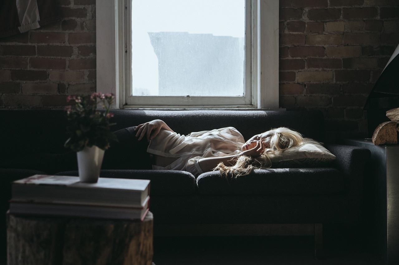 Woman sleeping under window