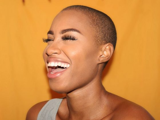 Smiling bald headed woman