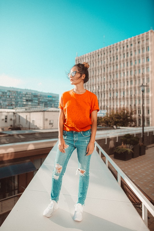 Woman in cool ripped jeans