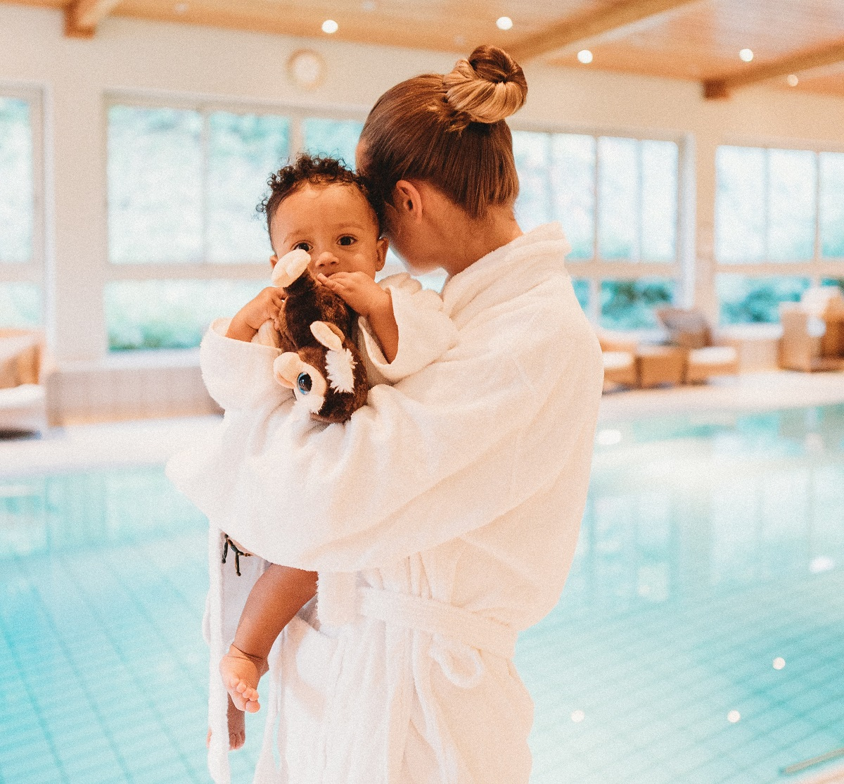 Woman in spa with baby
