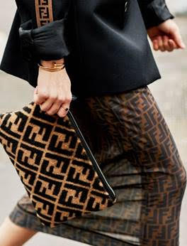 woman carrying Fendi bag
