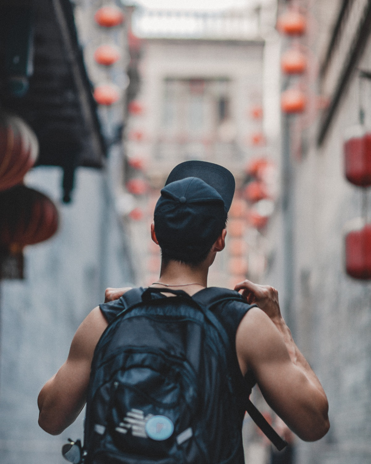 young man in a backpack travelling