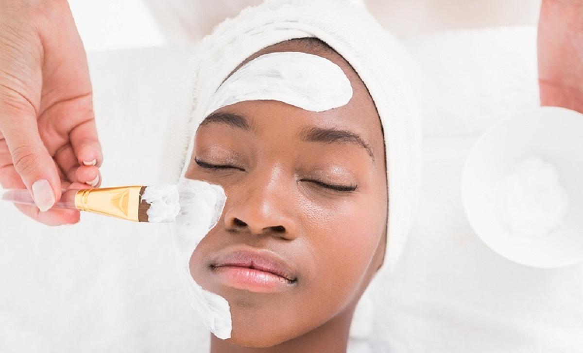 Black woman having facial treatment