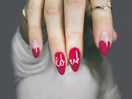 Woman with nail polish and love written on nails