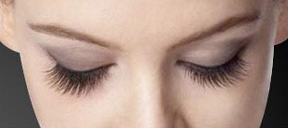 Woman looking downwards displaying her lashes