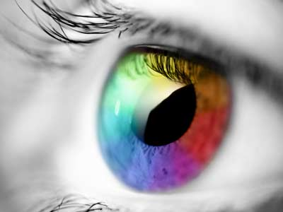 Close up picture of an eye with multi coloured lens