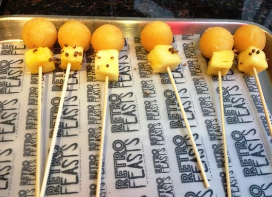 Cheese and pineapple on sticks