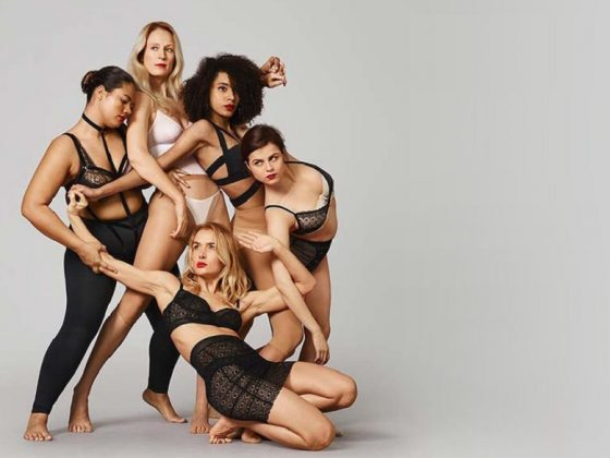 Women of various sizes and races posing together