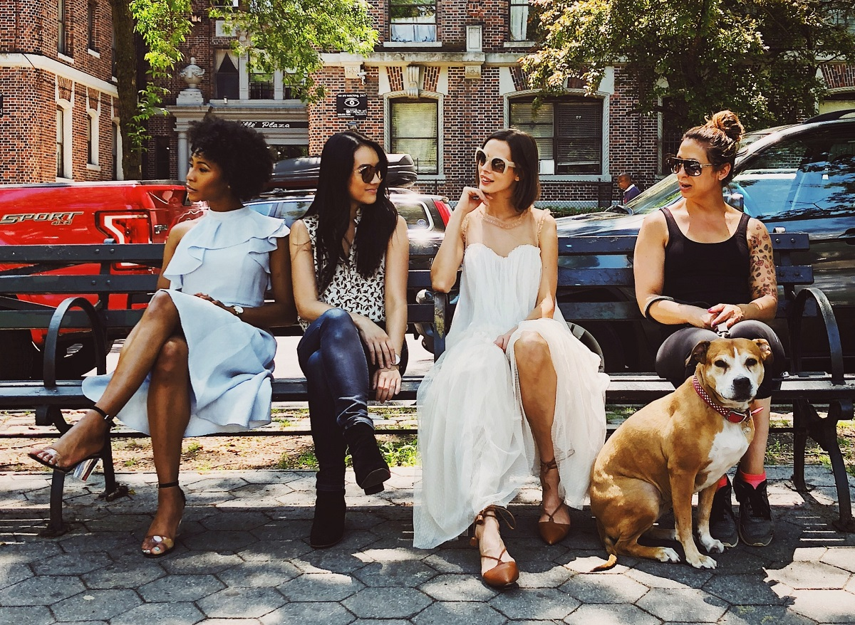 Women sitting on a bench chatting