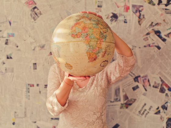 Woman with world globe