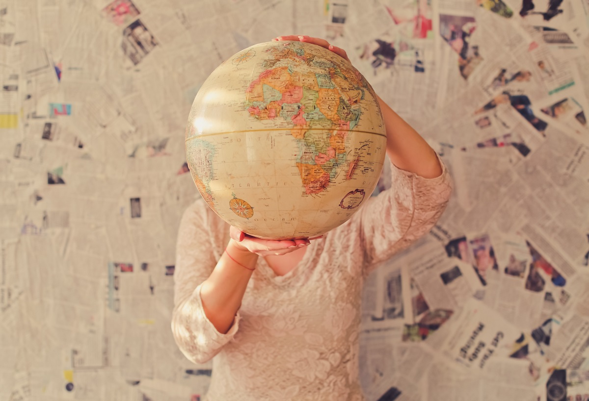 Woman with world globe